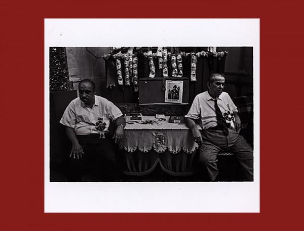 2 Men sitting in front san Gennaro